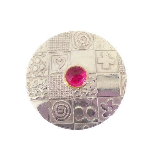 Round brooch, contemporary patterned sterling silver with a pink corundum stone
